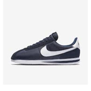 navy blue and white cortez